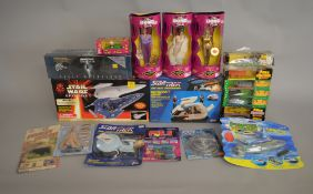 A mixed lot which includes; PK6.6 spud gun, The Bond Girls posable action figures x3, Star Wars Game