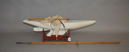 A wooden scratch built Pond Yacht, approximate overall length 87cm complete with wooden stand.