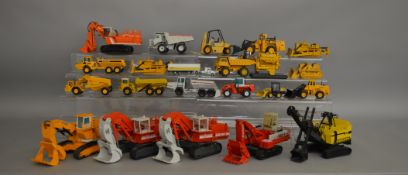 22 unboxed construction and agricultural related die-cast models by NZG, Conrad etc contained in 2