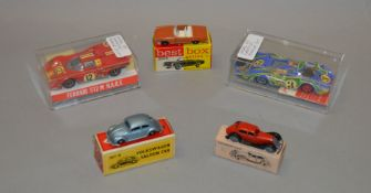 5 boxed diecast model cars including two by Champion (France) - a Porsche 917 and a Ferrari 512M