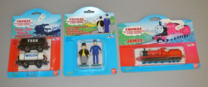 3 Bandai Thomas The Tank Engine carded models; James, Fat Controller & Porter and 2 tanker wagons (