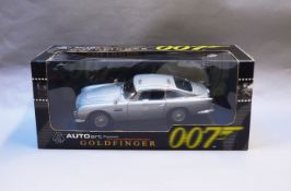 James Bond 007. A boxed Autoart 1:18 scale Aston Martin DB5 version with Gadjets and Roof Panel,