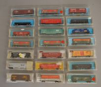 N Gauge. EX SHOP STOCK. 20 boxed items of Rolling Stock by Atlas which include 40' and 50' Box Cars,