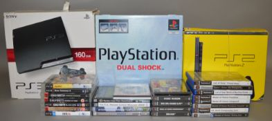 A boxed Sony PlayStation 'Dual Shock' Set containing Console, Controller etc. together with two