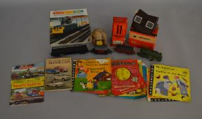 A mixed group of vintage toys, mainly unboxed, including a Nomura (Japan) clockwork drummer with