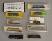 N Gauge. EX SHOP STOCK. Three boxed locomotives including two by Model Power a #7512 Alco Century