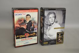 James Bond 007. 2 boxed Sideshow 12 inch action figures from the film 'Goldfinger', issued in
