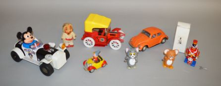 A small collection of battery operated plastic and tin toys which includes Modern Toys Tom and