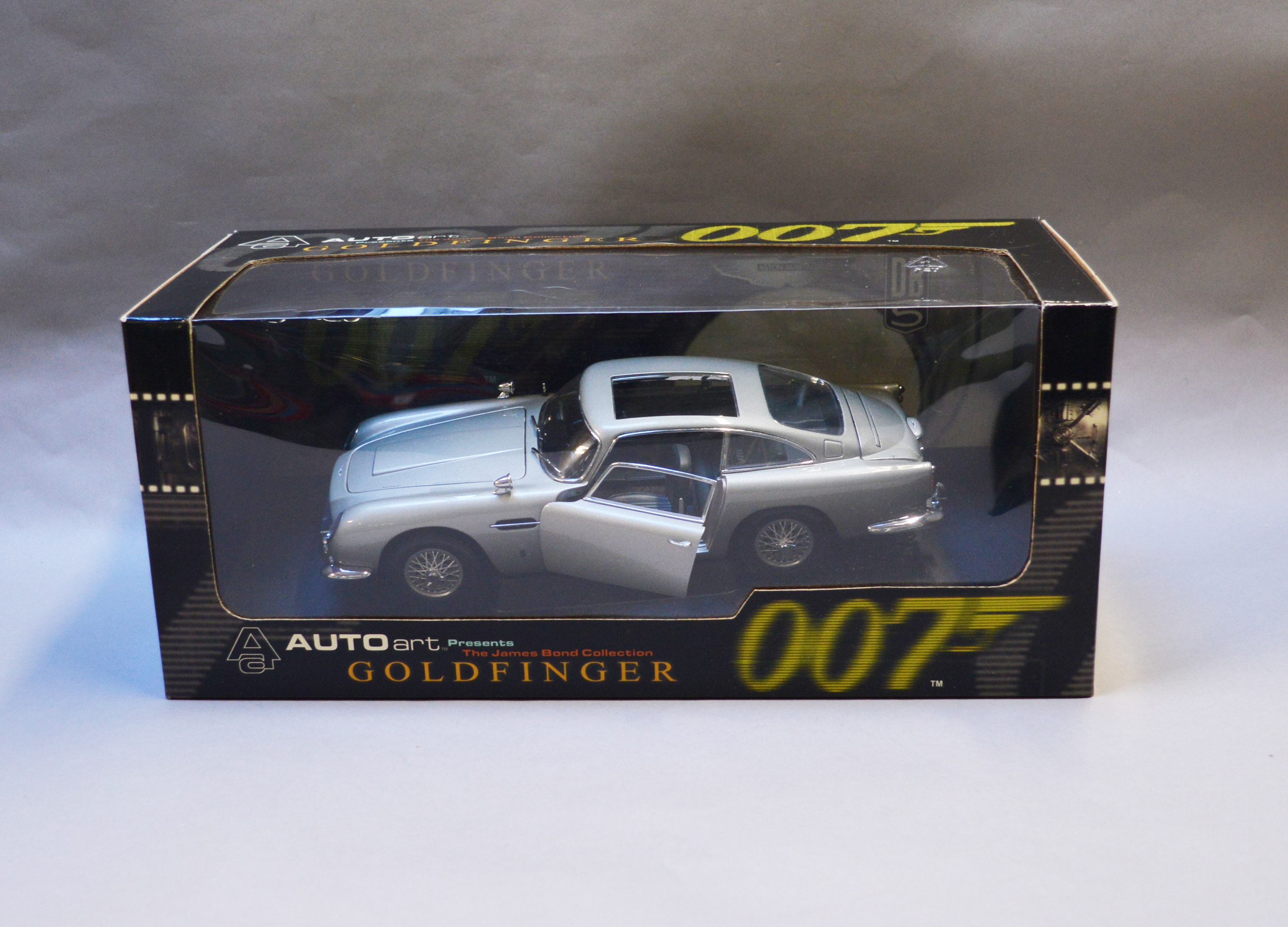 Lot 13 - James Bond 007. A boxed Autoart 1:18 scale Aston Martin DB5 version with Gadjets and no Roof