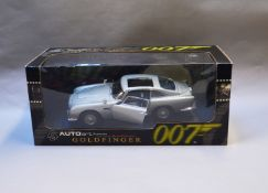 James Bond 007. A boxed Autoart 1:18 scale Aston Martin DB5 version with Gadjets and no Roof