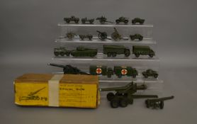 A boxed Britains #2064 155mm gun with some damage, together with 18 unboxed Military models which