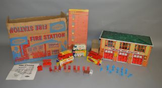 A scarce boxed Mettoy #6259 tinplate County Fire Station.  The tinplate two storey building measures