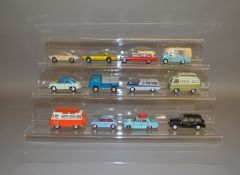 12 unboxed Corgi Toys with varying degrees of play wear including 202 Morris Cowley mid blue over