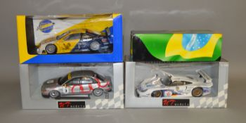 3 boxed UT Models diecast car models in 1:18 scale including an Opel Calibra V6, a Porsche 911 GTI