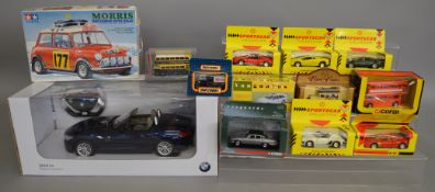 A boxed dealership BMW Z4 radio control model in 1:12 scale together with 11 boxed diecast models by