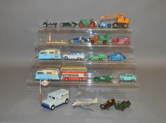 21 unboxed Dinky Toys with varying degrees of play wear, including #129 Volkswagen De Luxe Saloon,