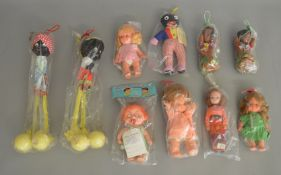 An interesting selection of vintage 'Made in Hong Kong' plastic and padded dolls, most appear to