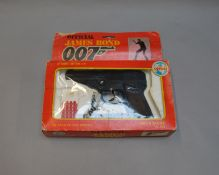 James Bond 007. A boxed Coibel James Bond Secret Agent 12 shot Automatic Cap Gun, from 1985, which