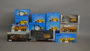 12 boxed Volvo construction related die-cast models by Scoop, Motorart etc (12).