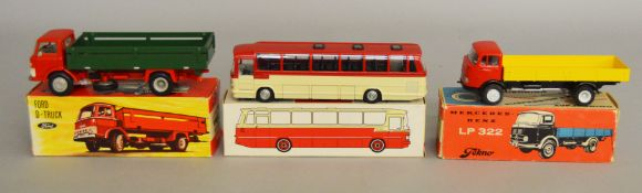 3 boxed Tekno diecast models including 911 Mercedes Benz LP322 Truck in red/yellow, a 915 Ford D