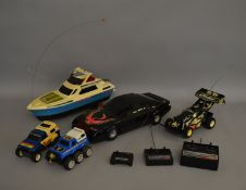 3 unboxed Nikko Radio Control Models including a Racing Car, a Toyota Hilux Off Road vehicle and a