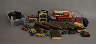 A quantity of unboxed Locomotive shells, motors, coaches, wagons and a British Railways rule book