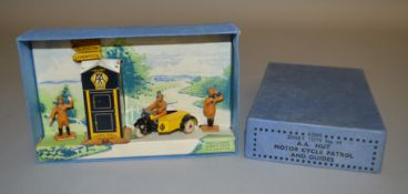 A boxed Pre War Dinky Toys 44 'A.A.' Set, containing tinplate A.A. Hut, Motor Cycle Patrol and two