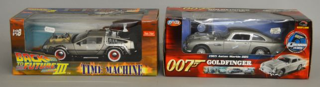 Back To The Future III die-cast time machine by Sun Star together with a James Bond 1965 Aston