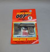 James Bond 007. A carded Coibel James Bond Secret Agent 'Hideaway Pistol', from 1985. The card