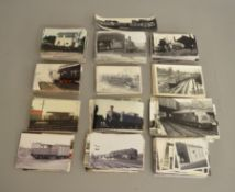A quantity of vintage and more modern black/white and colour railway related photographs, mostly