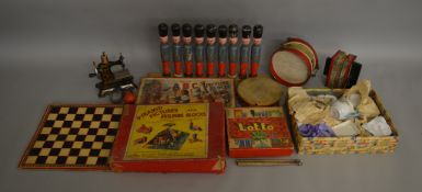 An interesting selection of vintage toys including a Japanese ceramic 'Toy Tea Set', a boxed '