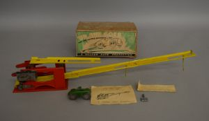 A boxed vintage mechanical  toy 'Up She Goes' by Golden Gate (UK) comprising tinplate track with