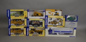 11 die-cast Komatsu boxed models, which includes; Dump Truck, Bulldozer, Backhoe Loader etc (11).