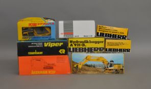 7 boxed construction related die-cast models by Liebherr, NZG etc (7).