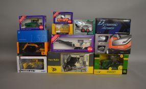12 boxed construction and agricultural related die-cast models by; MotorArt, Conrad, Britains,