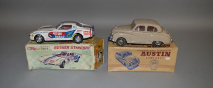 A boxed Taiyo tinplate Rusher Stingray Corvette along with a boxed Electric Austin Somerset by