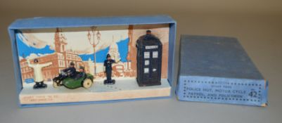 A boxed Pre War Dinky Toys 42 Police Set, containing Police Hut, Motor Cycle Patrol and two