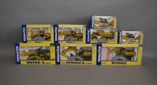 8 Joal die-cast Komatsu boxed models, which includes; Log Loader, Wheel Loader, Bulldozer etc (8).