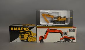 3 construction related die-cast boxed models by Dresser, Liebherr and Poclain (3).