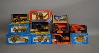 11 construction related boxed die-cast models by ERTL, which includes; John Deere, Mighty Movers etc