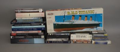 A collection of Titanic related items which includes; books, CD's DVD's, a model kit and a dinner