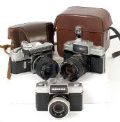 Three Nikkorex 35mm Cameras.