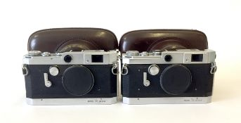 Two Canon Rangefinder Camera Bodies with Cases.