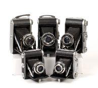 Five Ensign Folding Roll Film Cameras.