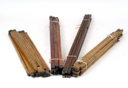 Four Sets of Tripod Legs for Wood & Brass Cameras.