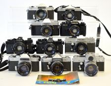 Group of Ten 35mm SLRs with Lenses.
