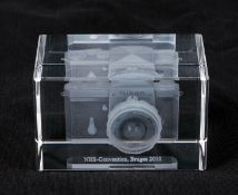 Small Perspex Paperweight Featuring a Nikon F.