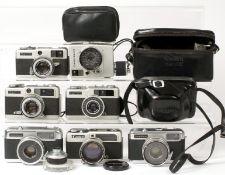 Group of Seven Half Frame Cameras.