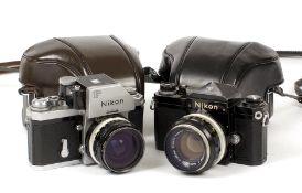 Two Nikon F Cameras.