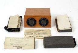 An Un-named, French Stereo Viewer with 4 Boxes Of Glass Slides.